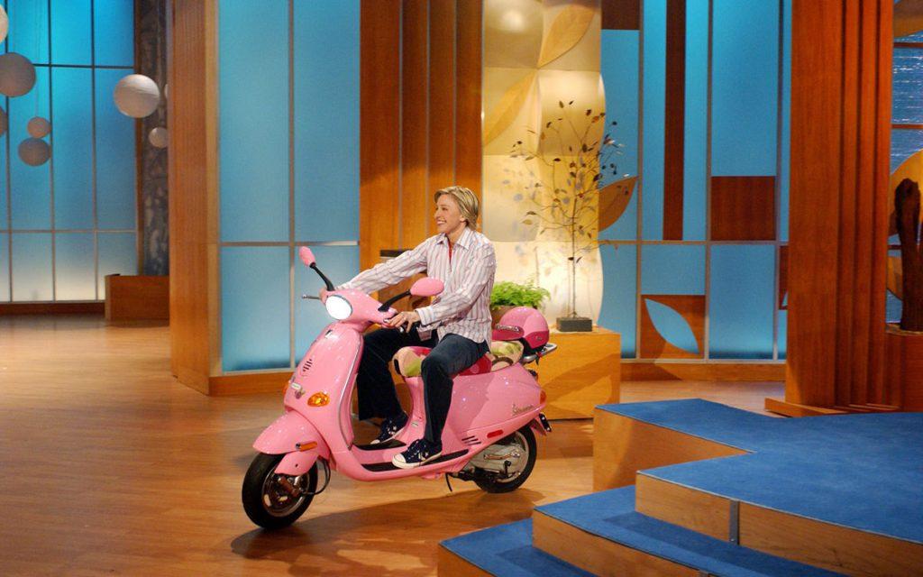 Ellen riding a Vespa
